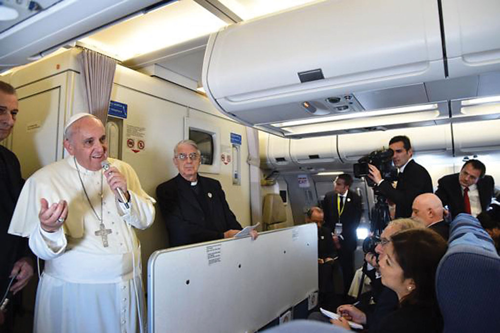 Pope Francis answers questions from journalists aboard his flight from Manila, Philippines, to Rome.