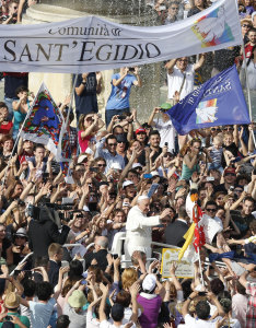 A sign for the Sant'Egidio Community is seen as Pope Francis arrives for a Pentecost prayer vigil with members of Catholic lay movements in St. Peter's Square at the Vatican on May 18. An estimated 200,000 people from 150 movements attended the vigil.