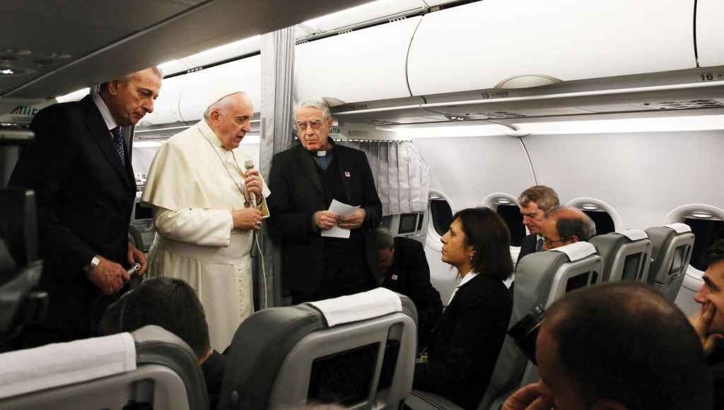 Pope Francis stands next to Father Federico Lombardi, S.J., during the Pope's airplane press conference on November 30, returning from Istanbul to Rome. His remarks about his willingness to meet with Russian Orthodox Patriarch Kirill raised eyebrows...
