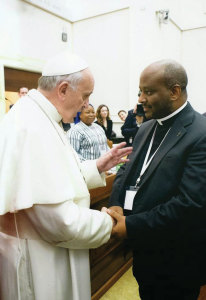 Pope Francis and Father Mussie Zerai.