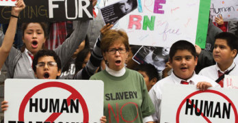 People display signs in Los Angeles at a demonstartion before the National Human Traffickin Awareness Day  last month.
