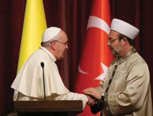 Below, Pope Francis meets the Turkish President of Religious Affairs Mehmet Gormez.