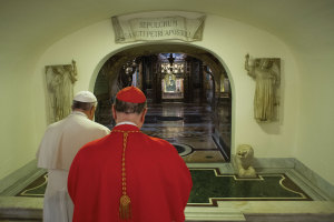 Pope Francis and Cardinal Angelo Comastri, archpriest of St. Peter's Basilica, pray in front of the tomb of St. Peter the Apostle in the crypt of the Basilica  on November 2, the Feast of All Souls.