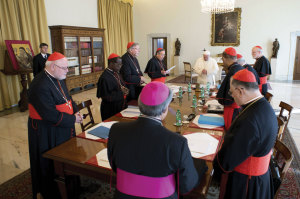Pope Francis prays during a meeting with cardinals at the Vatican October 1. As a series of consultations aimed at the reform of the Vatican bureaucracy began, the pontiff told his group of cardinal advisers that humility and service attract people to the Church, not power and pride.