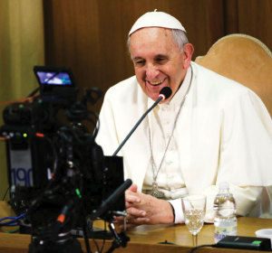 Pope Francis looks into a camera during a worldwide broadcast online as he leads a meeting for the Fourth World Congress of Educational Scholas Occurrentes February 5.
