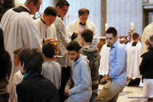 Young people receive Communion.