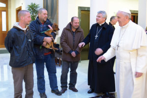 On December 17, 2013, Pope Francis talks with three men who live on the streets near the Vatican. As part of a low-key celebration of his 77th birthday, the Pope celebrated morning Mass and had breakfast with the men.