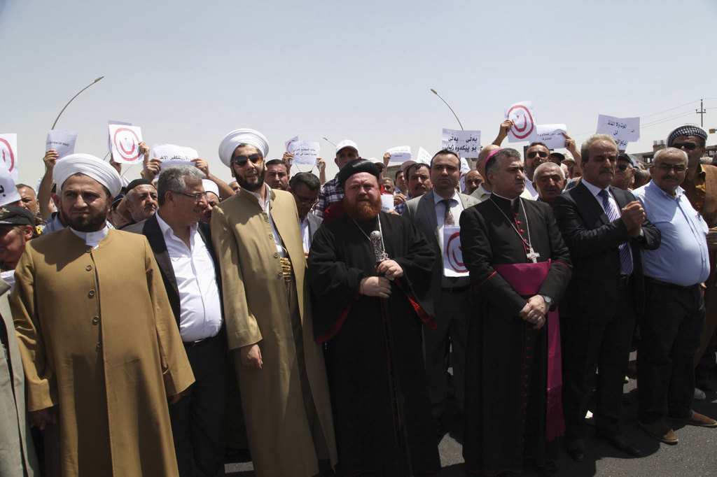 Demonstrators from various religions gather during a July 24 protest in Irbil, Iraq, against militants of the Islamic State.