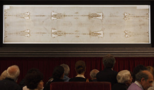 People viewing the shroud of Turin.