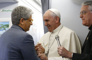 Pope Francis greets Vatican journalist Andrea Tornielli aboard on the Papal Flight to Brazil on July 22, 2013.