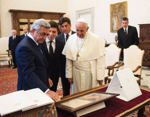 Pope Francis meets the President of the Republic of Armenia, Serzh Sargsyan, in the private library of the Apostolic Palace on September 19, 2014.
