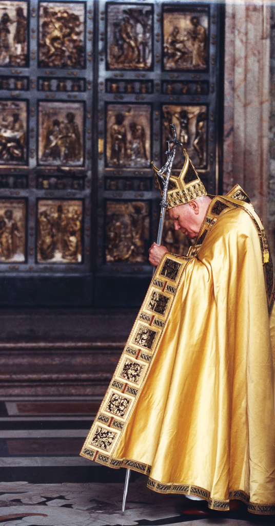 Pope John Paul II in front of the Holy Door in St. Peter's Basilica.