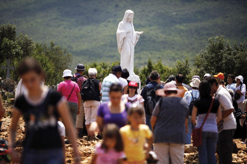 Pilgrims gather around a statue of Mary in Medjugorje, Bosnia-Herzegovina.