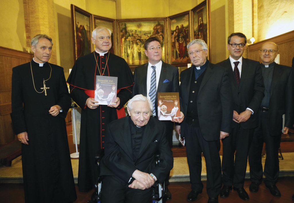 Presentation of Benedict XVI, a book commemorating the tenth anniversary of the election of Pope Benedict XVI on April 19, 2005. In the photo, from left to right, Benedict's personal secretary, Archbishop Georg Gaenswein; German Cardinal Gerhard Mueller; the retired Pope's 91-year-old brother, Msgr. Georg Ratzinger; Albrecht Weilard, director of the Schnell & Steiner publishing company of Regensburg (publisher of the German edition); Father Giuseppe Costa, director of the Vatican Press; Christian Schaller, vice director of the Institut Papst Benedikt XVI of Regensburg; and Msgr. Giuseppe Antonio Scotti, president of the Ratzinger Foundation (Siciliani/Gennari photo)