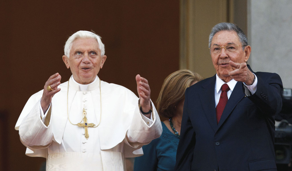 Pope Benedict XVI and Cuba's President Raul Castro gesture to the media as they appear for a photo opportunity outside the Palace of the Revolution in Havana March 27, 2012, just one year before his resignation (CNS photo/Paul Haring).