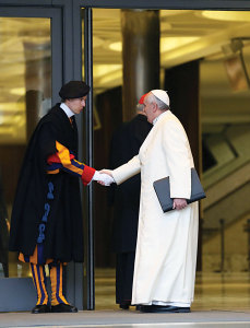 Pope Francis greets a Swiss Guard as he arrives for the works of the Consistory on February 13, 2015.