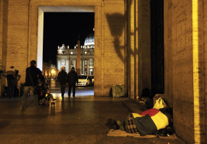 A homeless person sleeps outside the Vatican Press office near St. Peter's Square.