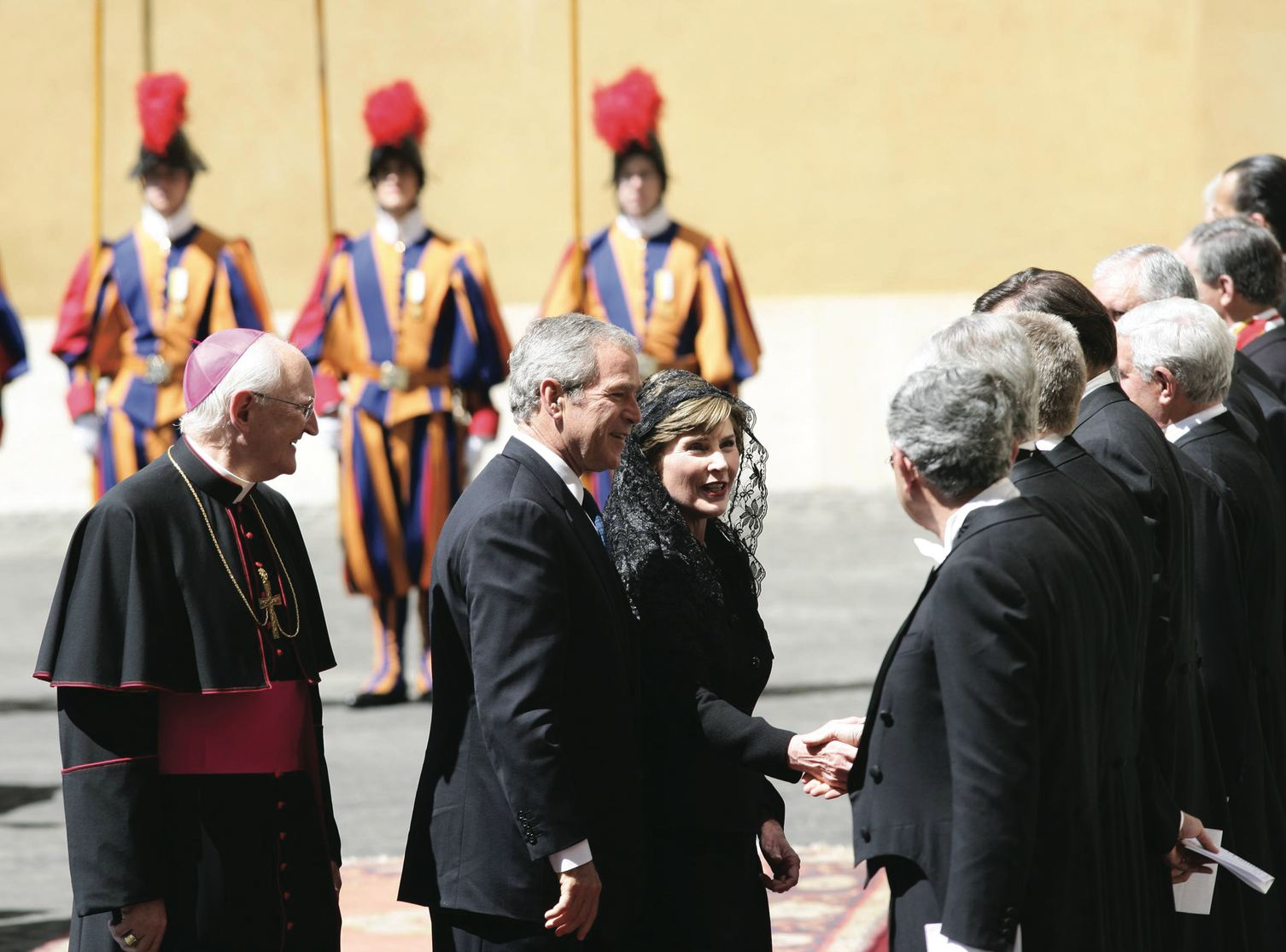 al diplomatic role. Right, the visit of President George W. Bush and his wife Laura to Pope Benedict XVI. Accompanying them was then Archbishop, now Cardinal James Harvey, whom Rooney cites with appreciation in his book (Galazka photo)