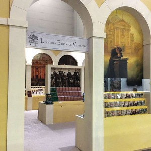 The entrance to the Vatican Publishing House at Turin's International Book Fair. The wall carries a gigantic photo of Don Bosco,  patron of publishers