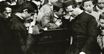 Don Bosco hears the confessions of his boys in his first oratory founded in Torino-Valdocco, where he began his work on April 12, 1846.