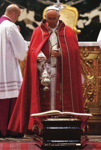 Pope Francis swings a censer over the coffin of Cardinal Roberto Tucci (inset) during funeral Mass at Vatican   (CNS photo)