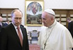 Pope Francis talks to Russian President Vladimir Putin during a meeting at the Vatican June 10. Putin, who was in Milan on other business, asked for the meeting (CNS photo/Maria Grazia Picciarella, Pool)