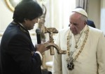Bolivian President Evo Morales presents a controversial gift to Pope Francis at the government palace in La Paz, Bolivia, on July 8. The gift was a wooden hammer and sickle — the symbol of communism — with a figure of a crucified Christ (CNS photo/L'Osservatore Romano).