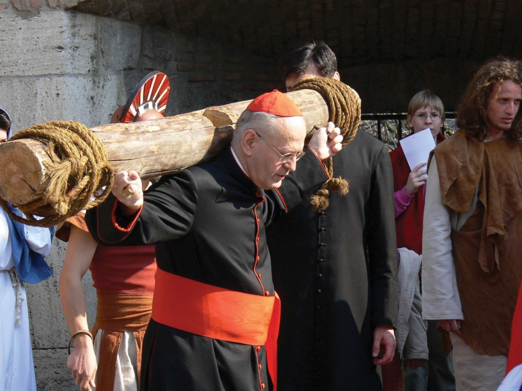 Cardinal Erdo carries a piece of the cross during a via crucis in Hungary