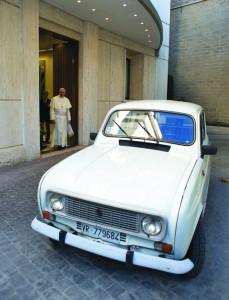 Pope Francis walks outside the Paul VI audience hall to accept a gift of a 1984 Renault at the Vatican Sept. 7. The silver-white four-door vehicle with 186,000 miles was donated by Father Renzo Zocca of Verona, Italy. (CNS photo/L'Osservatore Romano via Catholic Press Photo) (Sept. 10, 2013)