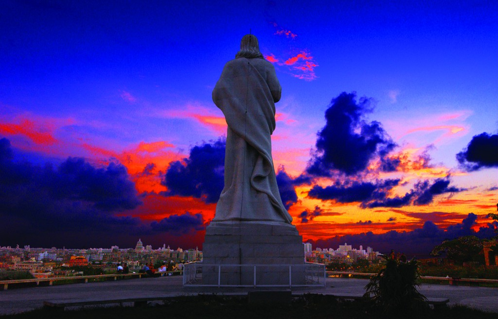 The Christ of Havana statue overlooks the harbor and city of Havana, Cuba, in this July 26, 2004, file photo. The imposing figure of Jesus Christ stands more than 60 feet tall and was sculpted from 600 tons of Carrara marble by Jilma Madera. The statue was inaugurated in 1958. (CNS photo/Ed Foster, Jr.) (May 17, 2006) See CUBA-STATUE May 17, 2006.