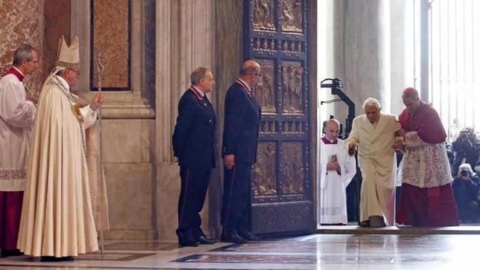 On Deember 8, 2015, after Pope Francis (left) passed through the Holy Door in St. Peter's Basilica, Emeritus Pope Benedict followed, helped by his personal secretary, Archbishop Georg Gaenswein