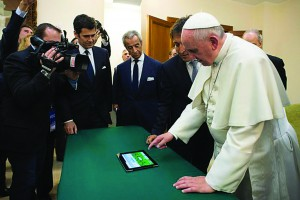 An handout photo released by the Vatican press office shows Pope Francis launching a tweet with Scholas Occurentes Argentina, a network to promote the meeting and linking of schools around the world, Vatican City, 19 March 2014. ANSA/L'OSSERVATORE ROMANO