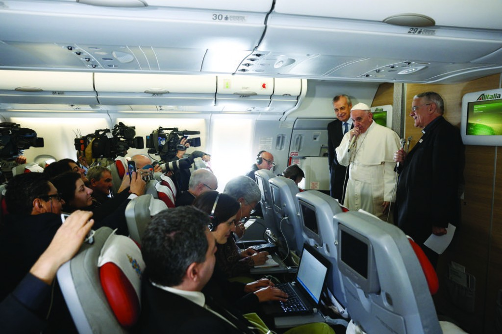 Pope Francis greets journalists aboard his flight to Havana Feb. 12. Traveling to Mexico for a six-day visit, the pope is stopping briefly in Cuba to meet with Russian Orthodox Patriarch Kirill of Moscow at the Havana airport. (CNS photo/Paul Haring) See POPE-PLANE-START Feb. 12, 2016.