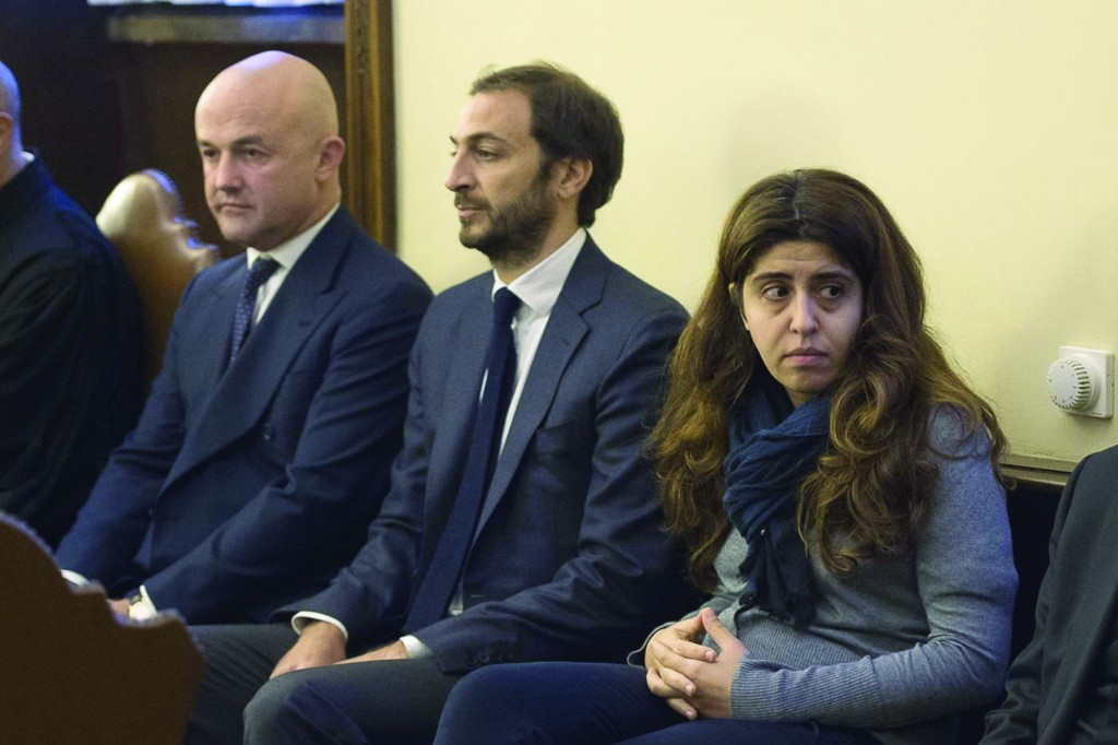 Italian journalists and authors Gianluigi Nuzzi and Emiliano Fittipaldi and Italian laywoman Francesca Chaouqui, a member of the former Pontifical Commission for Reference on the Organization of the Economic-Administrative Structure of the Holy See, are seen in a courtroom Nov. 24, the first day of the 'VatiLeaks' case at the Vatican. (CNS photo/L'Osservatore Romano via Reuters) See VATILEAKS-TRIAL Nov. 24, 2015.