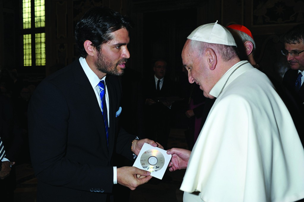 """Bella"" and ""Little Boy"" star and producer Eduardo Verastegui, a Catholic and part-time Miami resident, presents a copy of ""Little Boy"" to Pope Francis during a brief meeting in Rome earlier this month."