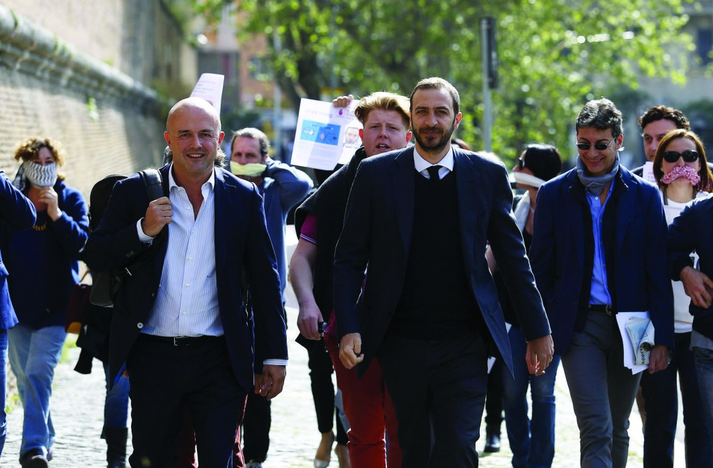 Journalists Gianluigi Nuzzi and Emiliano Fittipaldi, center, walk to their trial April 6 at the Vatican. Nuzzi and Fittipaldi are accused by the Vatican of soliciting the documents and exercising pressure on the defendants, especially Msgr. Vallejo Balda. (CNS photo/Remo Casilli, Reuters) See VATILEAKS-NUZZI April 13, 2016.