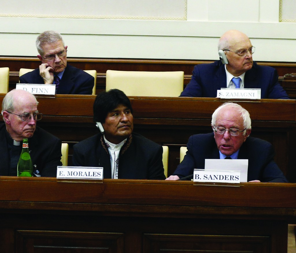 """Sen. Bernie Sanders, D-Vt., a U.S. presidential candidate, first row at right, speaks at a conference on Catholic social teaching at the Vatican April 15. The conference was dedicated to St. John Paul II's 1991 social encyclical """"Centesimus Annus"""" and was sponsored by the Pontifical Academy of Social Sciences and the Institutute for Advanced Catholic Studies. At left in the first row is Bishop Marcelo Sanchez Sorondo, chancellor of the academy, who invited Sanders. (CNS photo/Paul Haring) See VATICAN-ACADEMY-ECONOMICS-SANDERS April 15, 2016."""