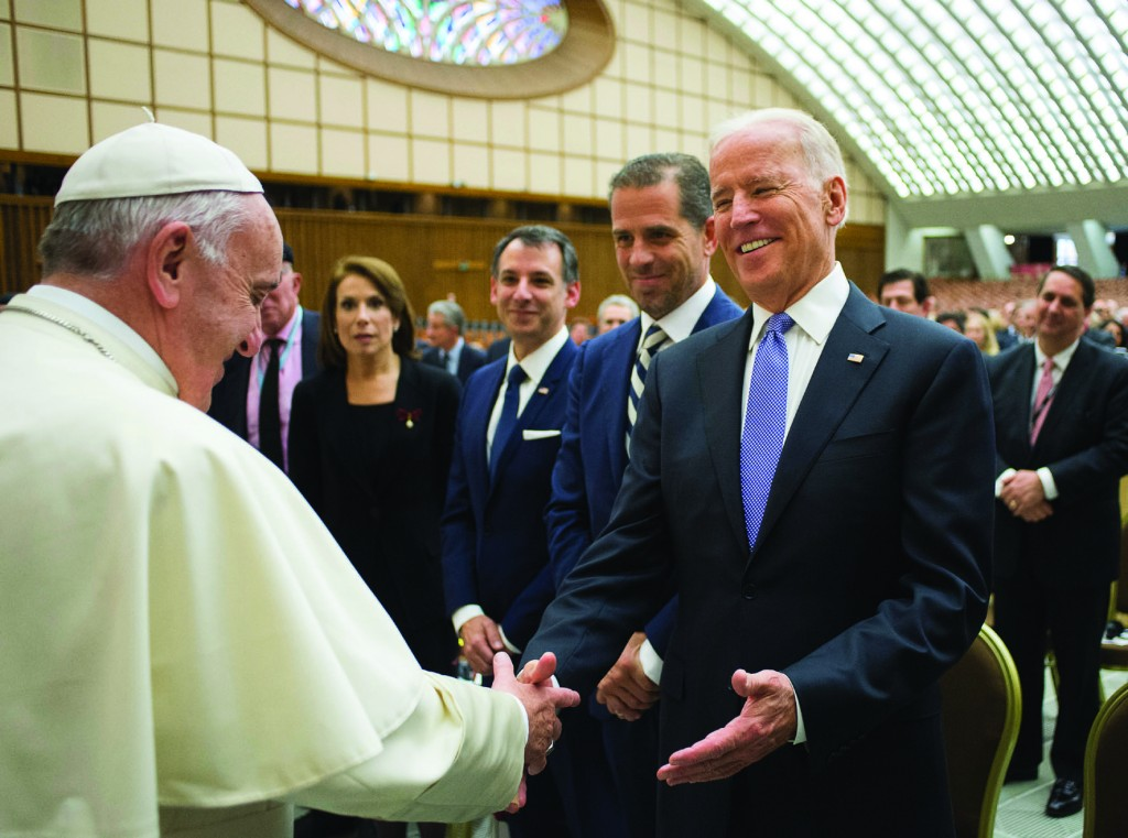 Pope Francis greets U.S. Vice President Joe Biden after both spoke at a conference on adult stem cell research at the Vatican April 29. (CNS photo/L'Osservatore Romano, handout) See POPE-BIDEN-CANCER April 29, 2016.