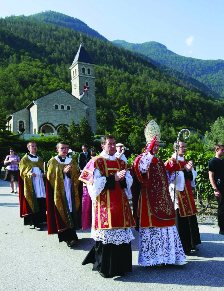 Bishop Bernard Fellay, superior of the Society of St. Pius X, waves as he arrives for an ordination ceremony in Econe, Switzerland, June 29. The Swiss-based organization rejects some of the reforms of the Second Vatican Council. (CNS photo/Denis Balibouse, Reuters) (June 29, 2012)