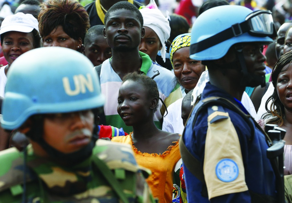 U.N. troops guard outside Barthelemy Boganda Stadium as the crowd waits for Pope Francis' arrival to celebrate Mass at the stadium in Bangui, Central African Republic, Nov. 30. (CNS photo/Paul Haring) See POPE-BANGUI-PEACE Nov. 30, 2015.