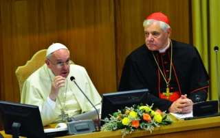 Pope Francis seated next to Cardinal Gerhard Muller