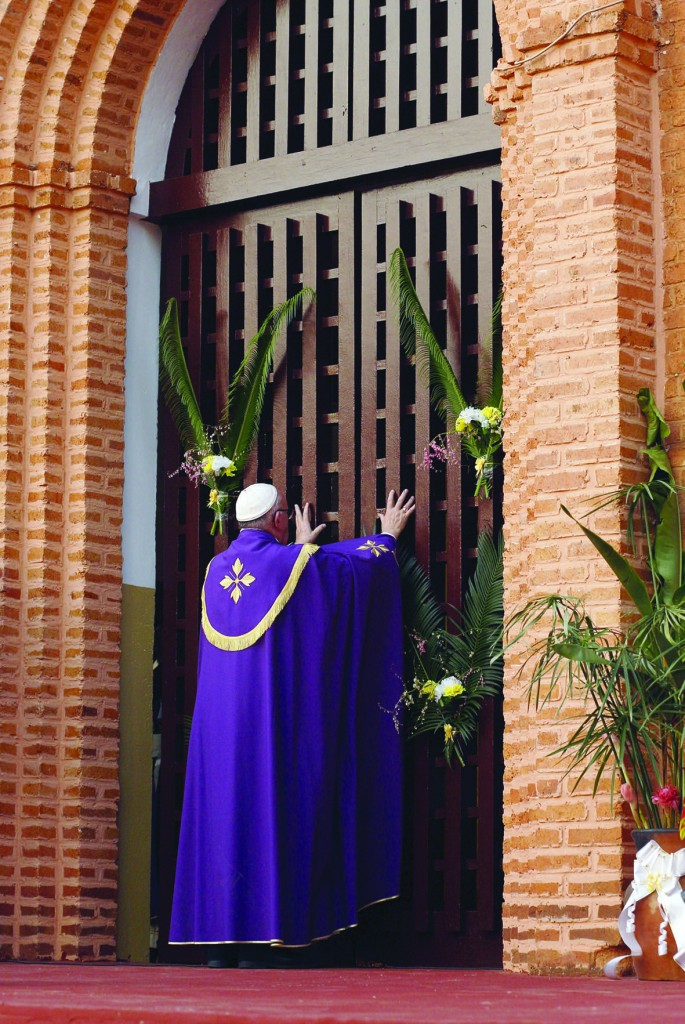 Pope Francis opens the Holy Door as he begins the Holy Year of Mercy at the start of a Mass with priests, religious, catechists and youths at the cathedral in Bangui, Central African Republic, Nov. 29. (CNS photo/Paul Haring) See POPE-BANGUI-MERCY Nov. 29, 2015.
