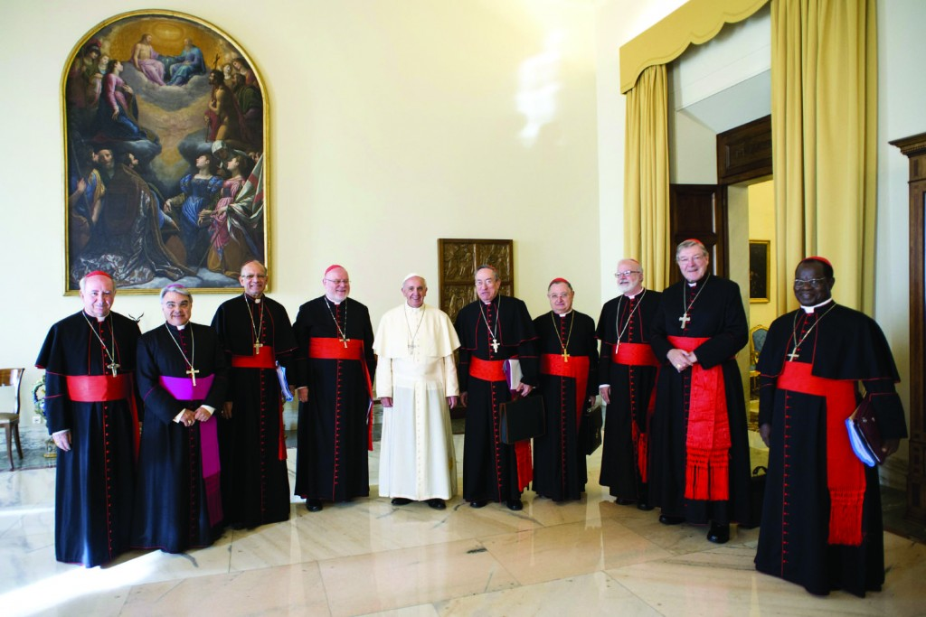 Pope Francis poses with cardinal advisers during a meeting at the Vatican Oct. 1. Eight cardinals began closed-door meetings with the pope Oct. 1 to help him reform the Roman Curia and study possible changes in the worldwide Church. Pictured from left are: Chilean Cardinal Francisco Javier Errazuriz Ossa, Italian Bishop Marcello Semeraro, secretary to the Council of Cardinals, Indian Cardinal Oswald Gracias, German Cardinal Reinhard Marx, Pope Francis, Honduran Cardinal Oscar Rodriguez Maradiaga, Italian Cardinal Giuseppe Bertello, U.S. Cardinal Sean P. O'Malley, Australian Cardinal George Pell and Congolese Cardinal Laurent Monsengwo Pasinya. (CNS photo/L'Osservatore Romano via Reuters) (Oct. 1, 2013) See POPE-CARDINALS Sept. 30, 2013 and POPE-HUMILITY Oct. 1, 2013.