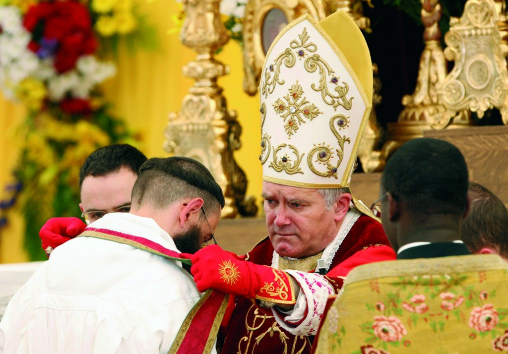 """Bishop Bernard Fellay, superior of the Society of St. Pius X, ordains a priest during a ceremony in Econe, Switzerland, June 29. The Vatican has said it considers such ordinations """"illegitimate,"""" although the priests are validly ordained. Earlier this year, Pope Benedict XVI lifted the excommunication of Bishop Fellay and three other bishops of the traditionalist society. (CNS photo/Denis Balibouse, Reuters) (June 29, 2009)"""
