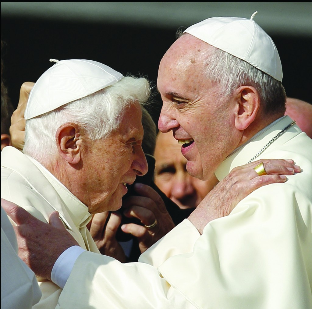 Pope Francis greets emeritus Pope Benedict XVI during an encounter for the elderly in St. Peter's Square at the Vatican Sept. 28. (CNS photo/Paul Haring) See POPE-ELDERLY Sept. 29, 2014.