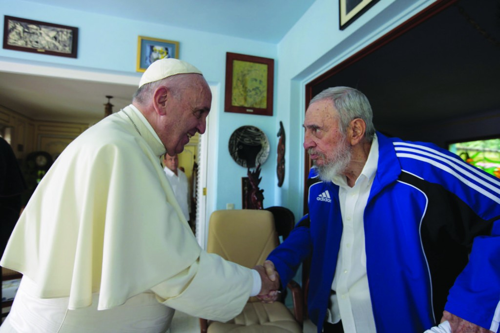 Pope Francis shakes hands with former Cuban President Fidel Castro at Castro's residence in Havana Sept. 20. (CNS photo/Alex Castro, Castro family handout via Reuters) See POPE-CASTRO Sept. 20, 2015.