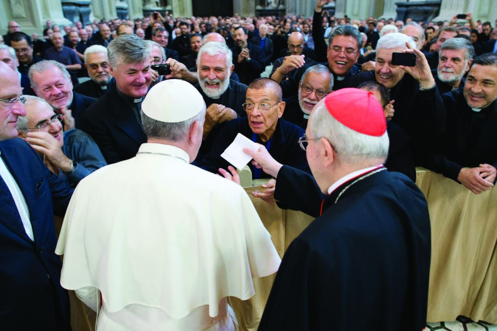Pope Francis is greeted by priests of the Diocese of Rome during his visit to the Basilica of St. John Lateran in Rome Sept. 16. At right is Cardinal Agostino Vallini, papal vicar for Rome. (CNS photo/L'Osservatore Romano via Reuters) (Sept. 17, 2013) See POPE-CLERGY Sept. 16, 2013.