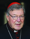 Australian Cardinal George Pell, prefect of the Vatican's Secretariat for the Economy, leaves the opening session of the extraordinary Synod of Bishops on the family at the Vatican in this Oct. 6 file photo. New rules for budgeting and financial reporting mandated by the Secretariat for the Economy will go into effect Jan. 1. The rules apply to all organs of the Holy See and Vatican City State and call for heightened transparency and consistency in the church's central administration. (CNS photo/Paul Haring) See VATICAN-FINANCIAL Nov. 10, 2014.