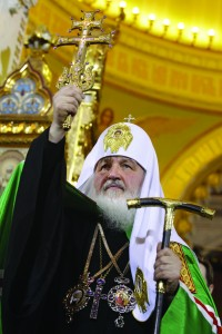 "Russian Orthodox Patriarch Kirill raises the cross during his enthronement service in Christ the Savior Cathedral in Moscow Feb. 1. Patriarch Kirill, the new leader of the world's 160 million Russian Orthodox, pledged to keep his church united, recruit the young and dialogue with ""sister churches."" (CNS photo/Reuters) (Feb. 2, 2009) See POPE-KIRILL (UPDATED) Feb. 2, 2009."