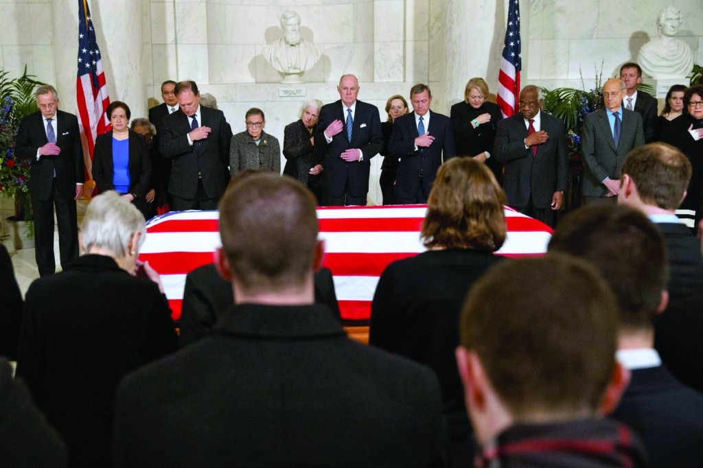 Supreme Court justices and family members listen to prayers near the casket of Justice Antonin Scalia at the Supreme Court in Washington Feb. 19. (CNS photo/Jacquelyn Martin, Reuters) See story to come.